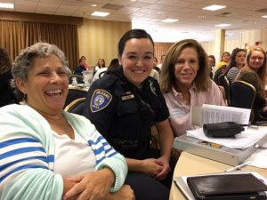 A school counselor, school safety office, and health teacher in attendance